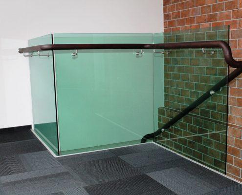 Wooden handrail in office building