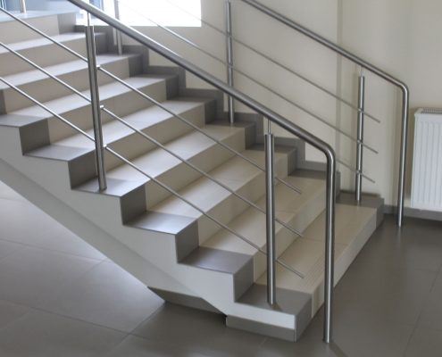 Staircase with stainless steel handrails