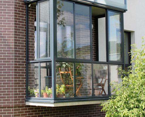 Fully glazed apartment balcony