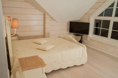 Log house bedroom interior