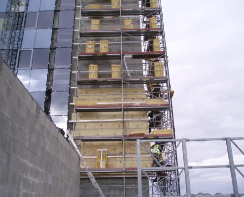Wall insulation installation on office building